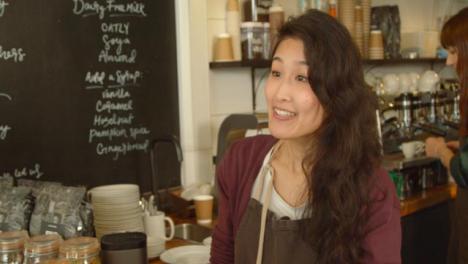 A-Woman-Walks-into-a-Coffee-Shop