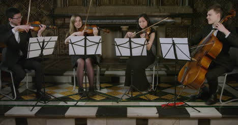 A-String-Quartet-Playing-Together-During-A-Performance