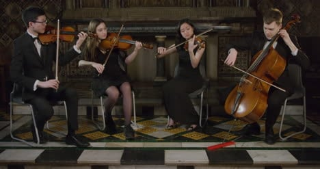 String-Quartet-Finishing-A-Piece-During-A-Performance
