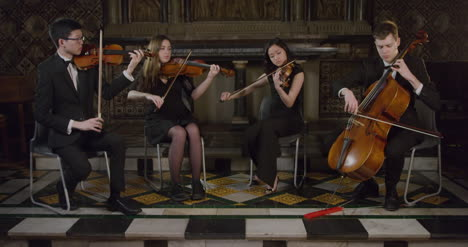 A-String-Quartet-Finishes-A-Piece-During-Performance