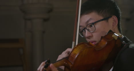 Close-Up-Male-Violinist-Plucking-Strings