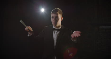 Male-Conductor-Conducting-During-A-Performance