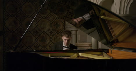 Male-Pianist-Playing-A-Grand-Piano