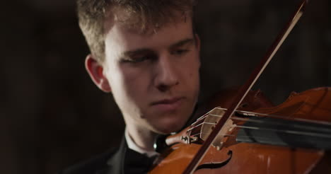 Tracking-In-From-Violin-To-Male-Violinist