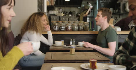 Couple-Talking-At-Table-In-A-Cafe