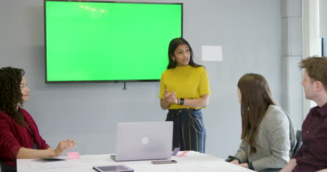 Woman-Leading-Meeting-With-Colleagues-Using-Green-Screen