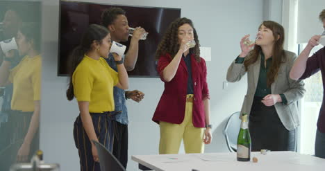 Happy-Team-Celebrate-At-Work-And-Pour-Champagne