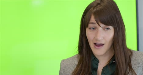 Tracking-Out-From-Woman-Talking-To-Colleagues-With-Green-Screen