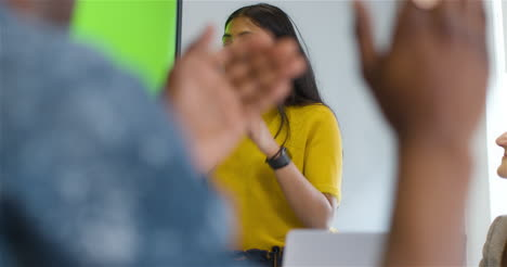 Happy-Businesswoman-Clapping-Colleagues-With-Green-Screen-Tv