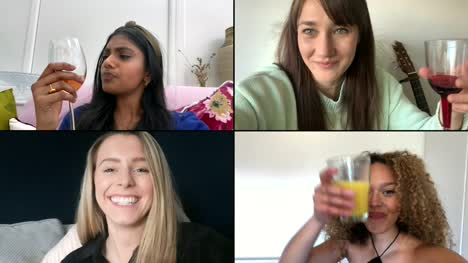 Four-Female-Friends-Saying-Cheers-Over-Video-Chat-