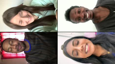 Four-Friends-Laughing-And-Joking-Over-Video-Chat-Vertical