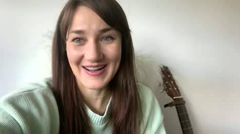 Caucasian-Woman-Giving-Happy-Engagement-News-Video-Call
