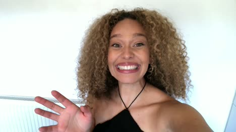 Mixed-Race-African-American-Woman-Giving-Good-News-Over-Video