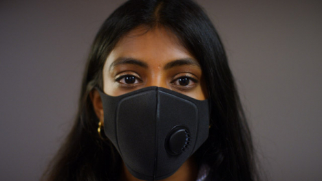 Young-Woman-Wearing-Face-Mask-Pull-Focus