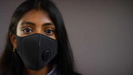 Young-Woman-Wearing-Face-Mask-Pull-Focus-Copy-Space