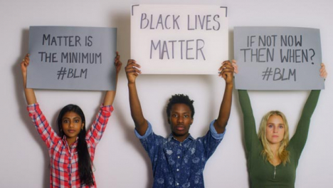 3-Young-People-Holding-Up-Black-Lives-Matter-Signs