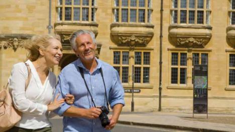 Medium-Shot-of-Middle-Aged-Tourist-Couple-Exploring-City