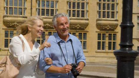 Medium-Shot-of-Middle-Aged-Tourist-Couple-Explore-City
