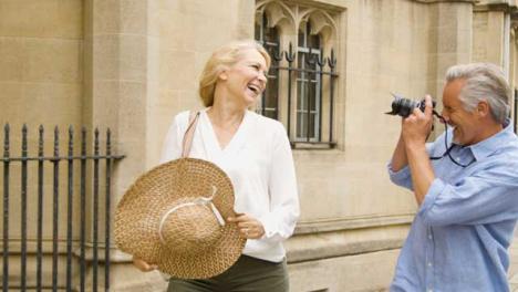 Medium-Shot-of-Middle-Aged-Tourist-Couple-Enjoying-City-City-Break