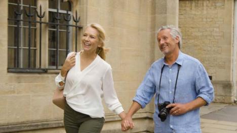 Tracking-Shot-of-Middle-Aged-Tourist-Couple-Enjoying-City-Break