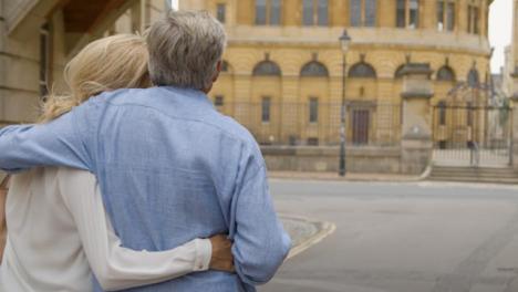 Tracking-Shot-of-Happy-Middle-Aged-Couple-Enjoying-City-Break