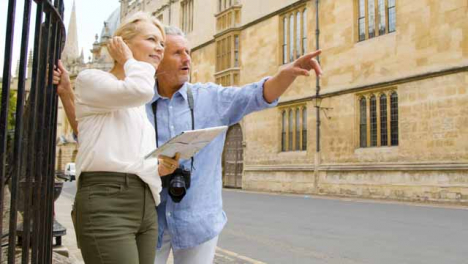 Medium-Panning-Shot-of-Middle-Aged-Couple-Reading-a-Map