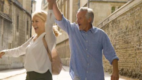 Medium-Tracking-Shot-of-Middle-Aged-Couple-Walking-Playfully