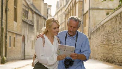 Medium-Tracking-Shot-of-Middle-Aged-Couple-Reading-Map-of-City