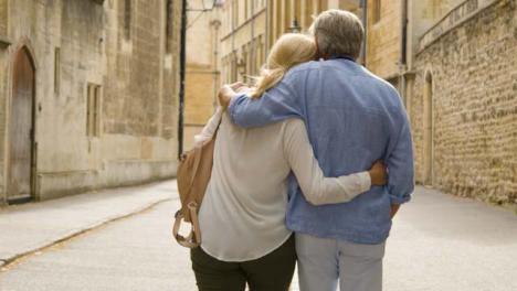 Medium-Tracking-Shot-of-Happy-Middle-Aged-Couple-Enjoying-City