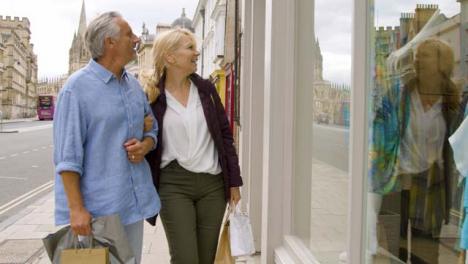 Medium-Shot-of-Middle-Aged-Tourist-Couple-Window-Shopping
