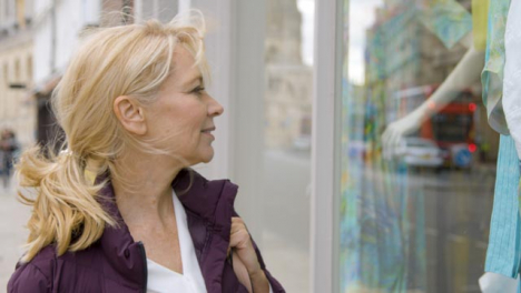 Close-Up-of-Middle-Aged-Woman-Window-Shopping-In-City