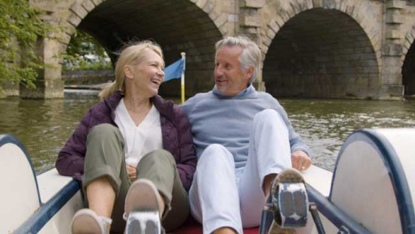 Medium-Shot-of-Middle-Aged-Tourist-Couple-In-Pedal-Boat