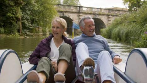 Medium-Shot-of-Middle-Aged-Tourist-Couple-Enjoying-Pedal-Boat