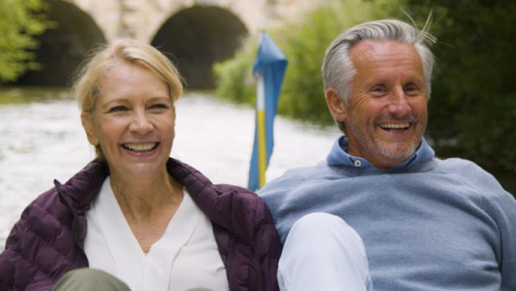 Close-Up-of-Middle-Aged-Tourist-Couple-In-Pedal-Boat