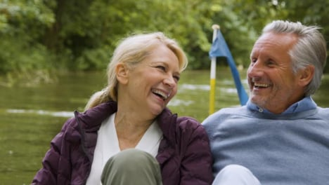 Close-Up-of-Middle-Aged-Tourist-Couple-Enjoying-Pedal-Boat