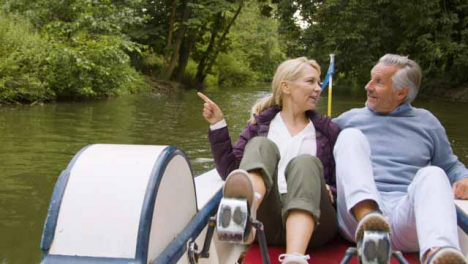 Wide-Shot-of-Middle-Aged-Tourist-Couple-Enjoying-Pedal-Boat