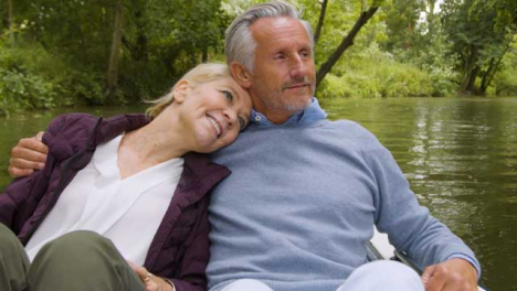 Close-Up-of-Middle-Aged-Couple-Enjoying-Scenery-From-Pedal-Boat