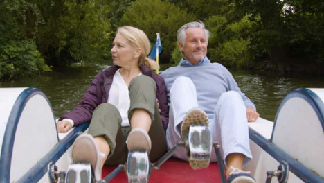 Wide-Shot-of-Middle-Aged-Tourist-Couple-In-Pedal-Boat