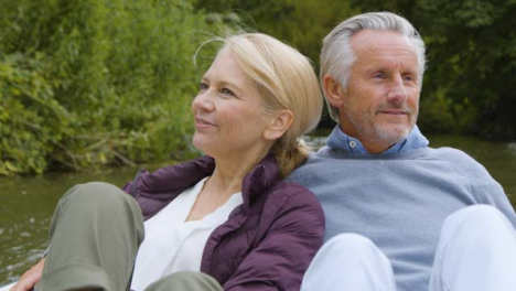 Close-Up-of-Middle-Aged-Tourist-Couple-Enjoying-Pedal-Boat-Ride