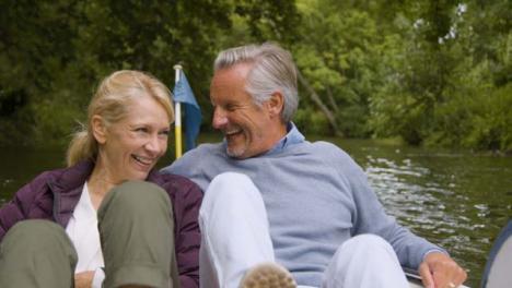 Medium-Shot-of-Middle-Aged-Tourist-Couple-Enjoying-Pedal-Boat-Ride