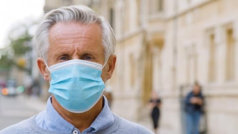 Close-Up-of-Middle-Aged-Man-Wearing-Face-Mask-In-City
