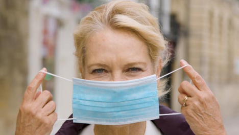 Close-Up-of-Middle-Aged-Woman-Wearing-a-Face-Mask-In-City