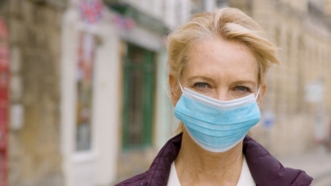 Close-Up-of-Middle-Aged-Woman-Wearing-Face-Mask-In-City