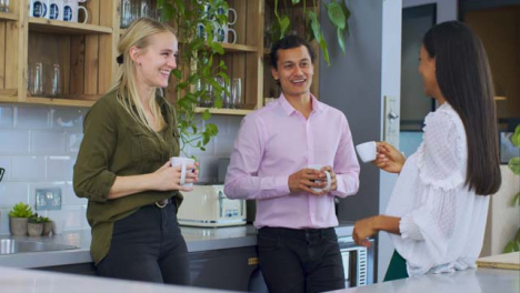 Medium-Shot-of-Colleagues-Talking-During-Tea-Break-