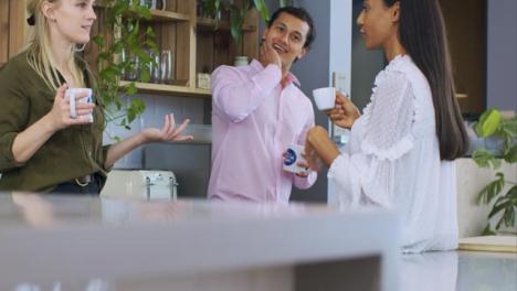 Medium-Shot-of-Woman-Joining-Colleagues-On-Tea-Break