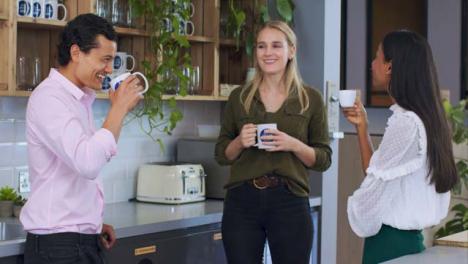 Medium-Shot-of-Work-Colleagues-Enjoying-Their-Tea-Break-
