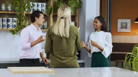 Medium-Panning-Shot-of-3-Work-Colleagues-Enjoying-a-Tea-Break