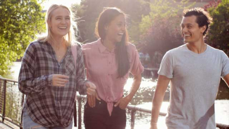 Tracking-Shot-of-3-Friends-Enjoying-Walk-Next-to-Canal