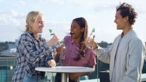 Medium-Shot-of-3-Friends-Enjoying-a-Drink-On-Roof-Terrace