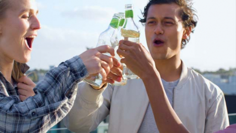 Close-Up-of-3-Friends-Enjoying-a-Drink-On-Roof-Terrace